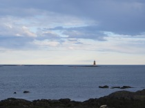 A lighthouse in Maine/Stands alone and reminds me/How vast is the blue