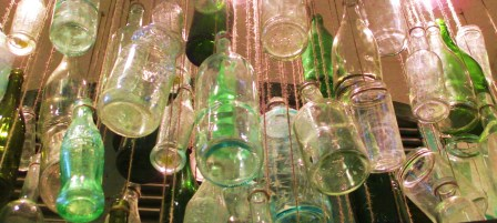 From below: hanging glass bottles
